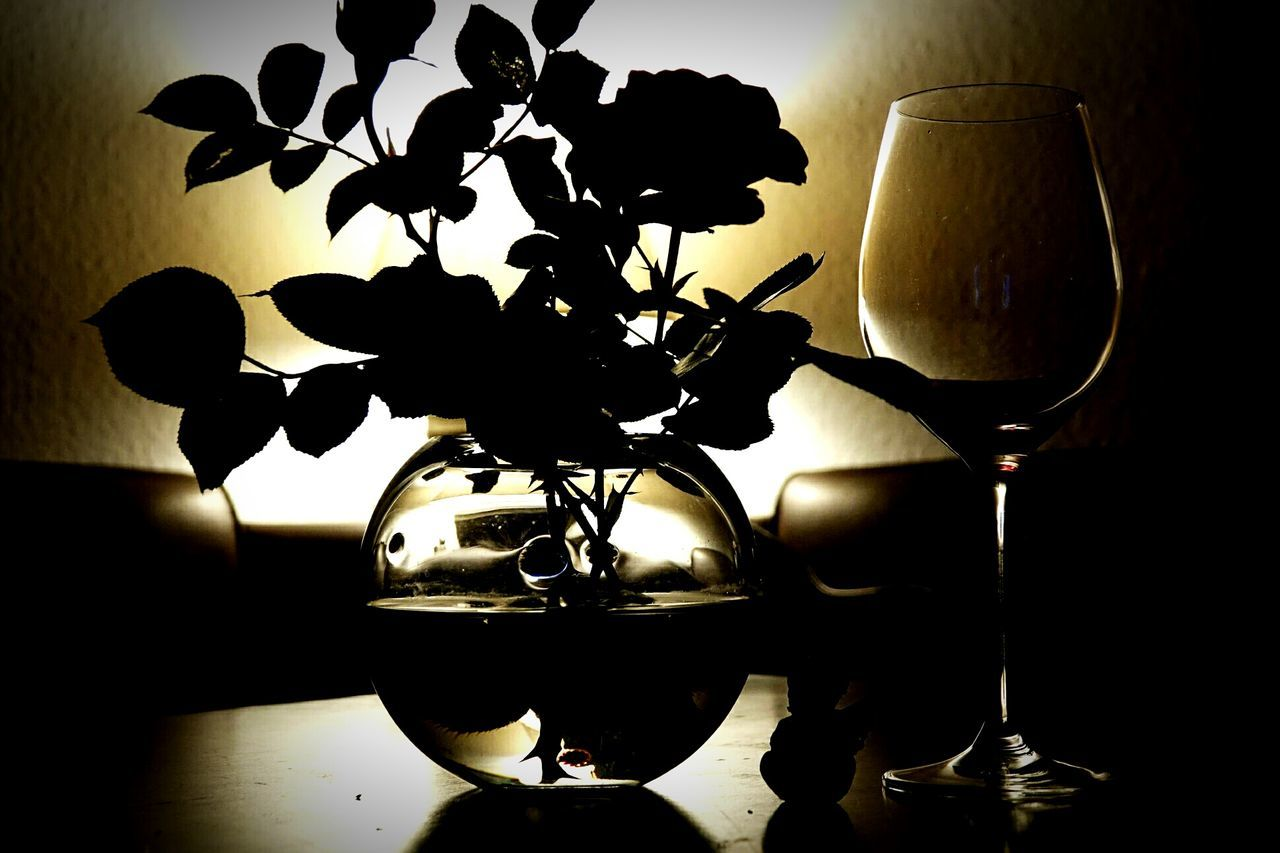 indoors, table, home interior, vase, no people, close-up, food and drink, flower, wineglass, illuminated, freshness, day