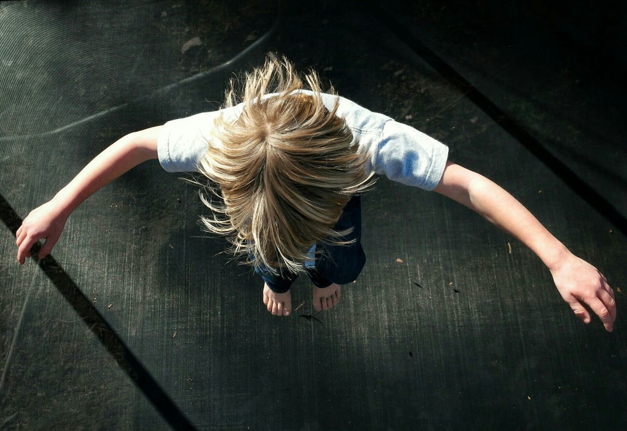 My son jumping in the sun. Together, we can Make Magic Happen with a simple action shot . jumping is always good times, and at our house boys will be boys. Adrenaline Junkie Capturing Freedom Youth Of Today trampoline From above Blonde Hair Joyful excited childhood creative angle Alternative Fitness A Bird's Eye View