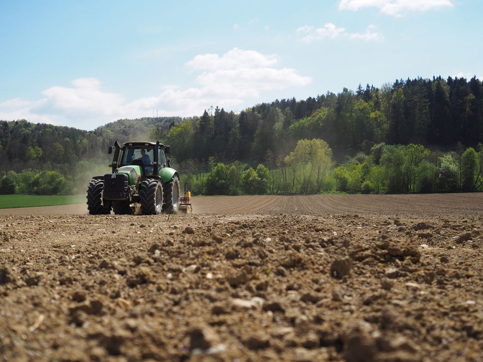 Agriculture Day Field Machinery Men Nature No People Outdoors Plowed Field Rural Scene Sky Sow Tractor Transportation Tree