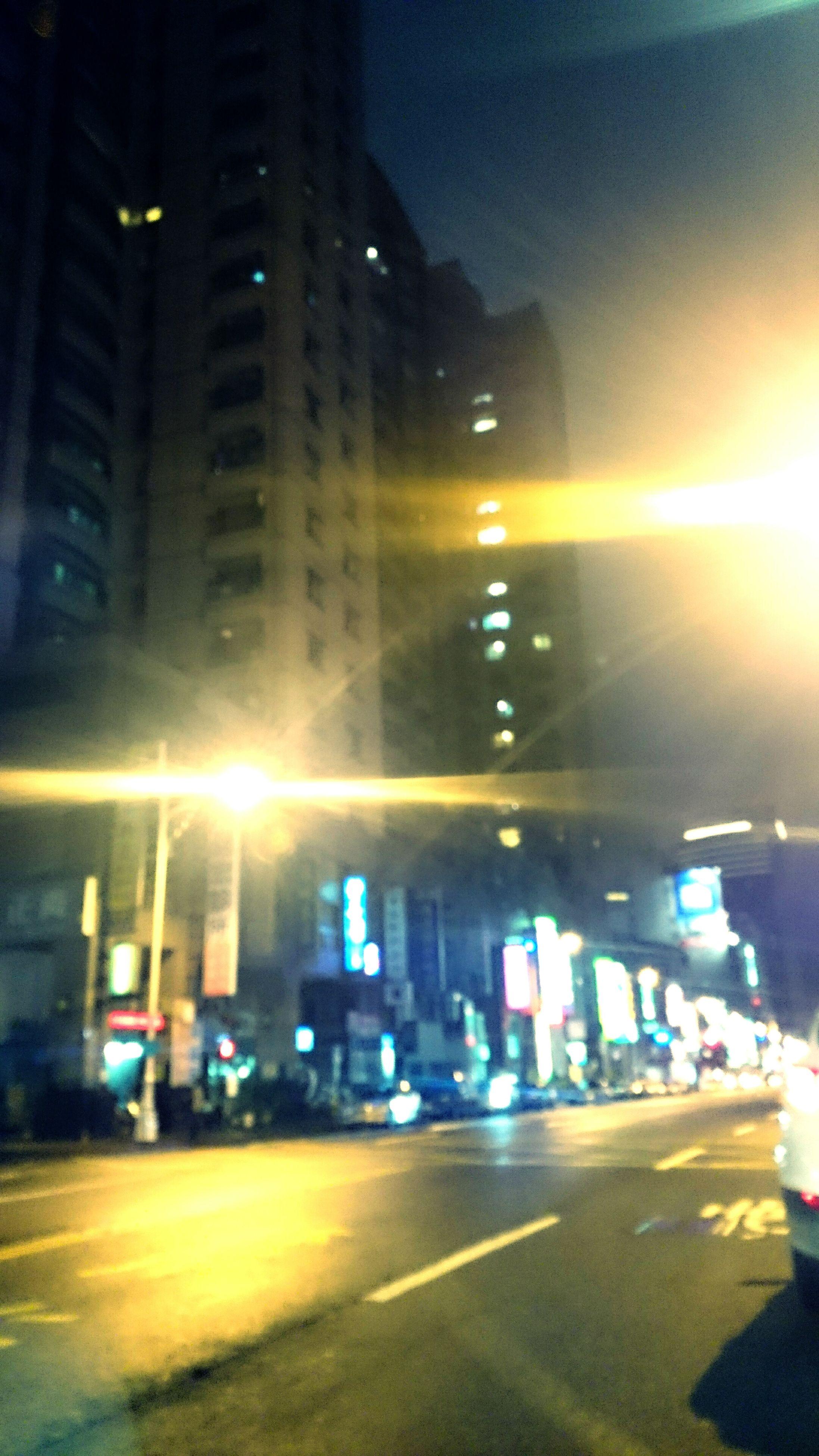 transportation, car, city, illuminated, land vehicle, mode of transport, building exterior, street, road, architecture, night, built structure, city street, traffic, street light, city life, road marking, on the move, sky, headlight