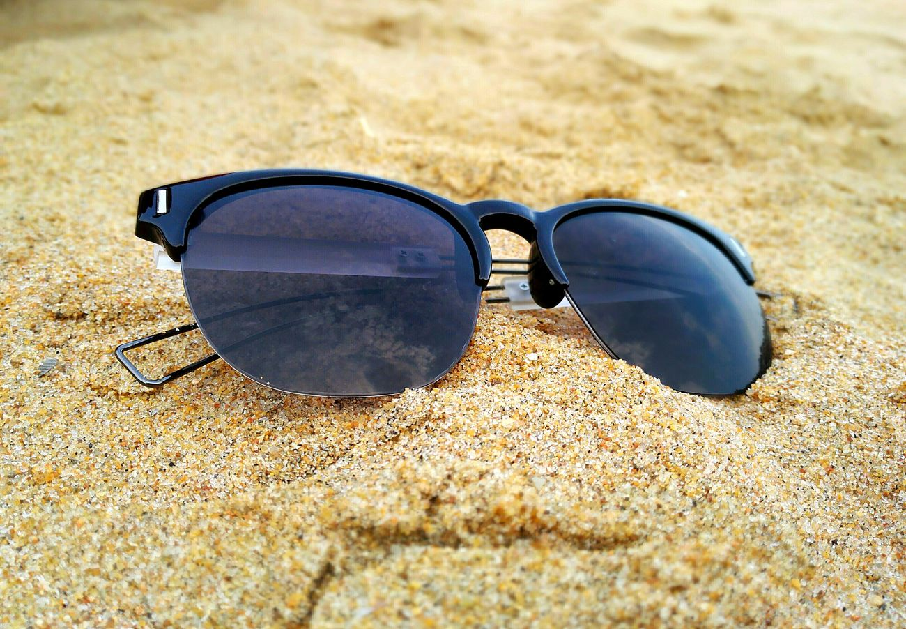The Essence Of Summer The Beach  Sand Shades Summer ☀ Hanging Out Sunny Day Fun In The Sun Sandy Feet Beachy Mood Sound Of Waves Sunglasses Enjoying Life