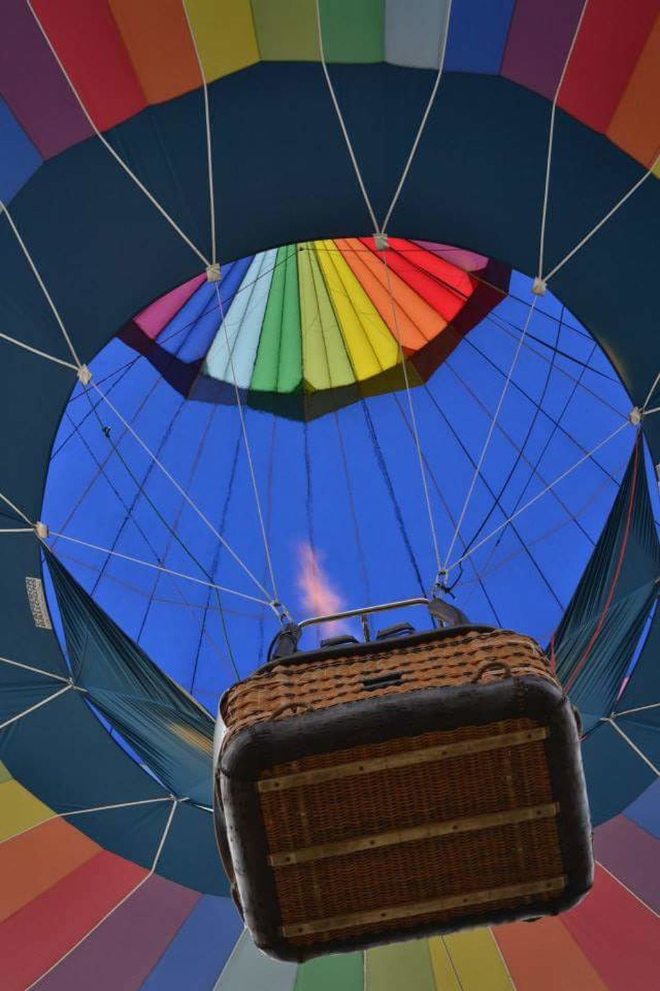 Multi Colored Hot Air Balloon Outdoors No People Close-up Parachute Colours Of Summer Colour Explosion Hobbies FreshonEyeem EyeEmNewHere Sky Day Fun Beautiful View Basket View From Below Flyingmachine Fire