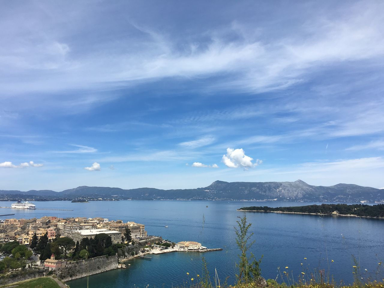 View of mountains and island from the Old Fortress, Corfu Town Beauty In Nature Blue Calm Cloud On The Way Coastline Corfu Town Day Idyllic Landscape Mountain Mountain Range Nature No People Non-urban Scene Ocean Outdoors Remote Scenics Sky Town Tranquil Scene Tranquility View From Old Fortress Water