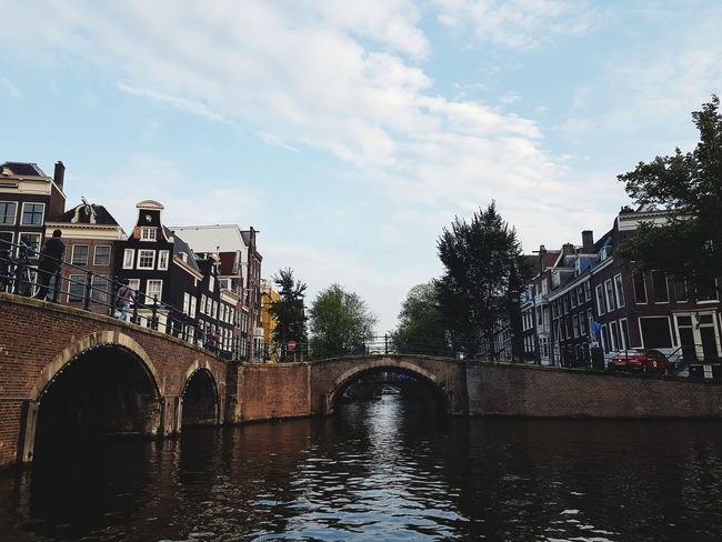Cloud - Sky Bridge - Man Made Structure Sky Arch Architecture Travel Destinations Built Structure Water Outdoors City No People Day Vacations Building Exterior Amsterdam Canal Amsterdam Canal Travelling Travel Photography Tranquility Travel Summer Sun Cityscape Tree