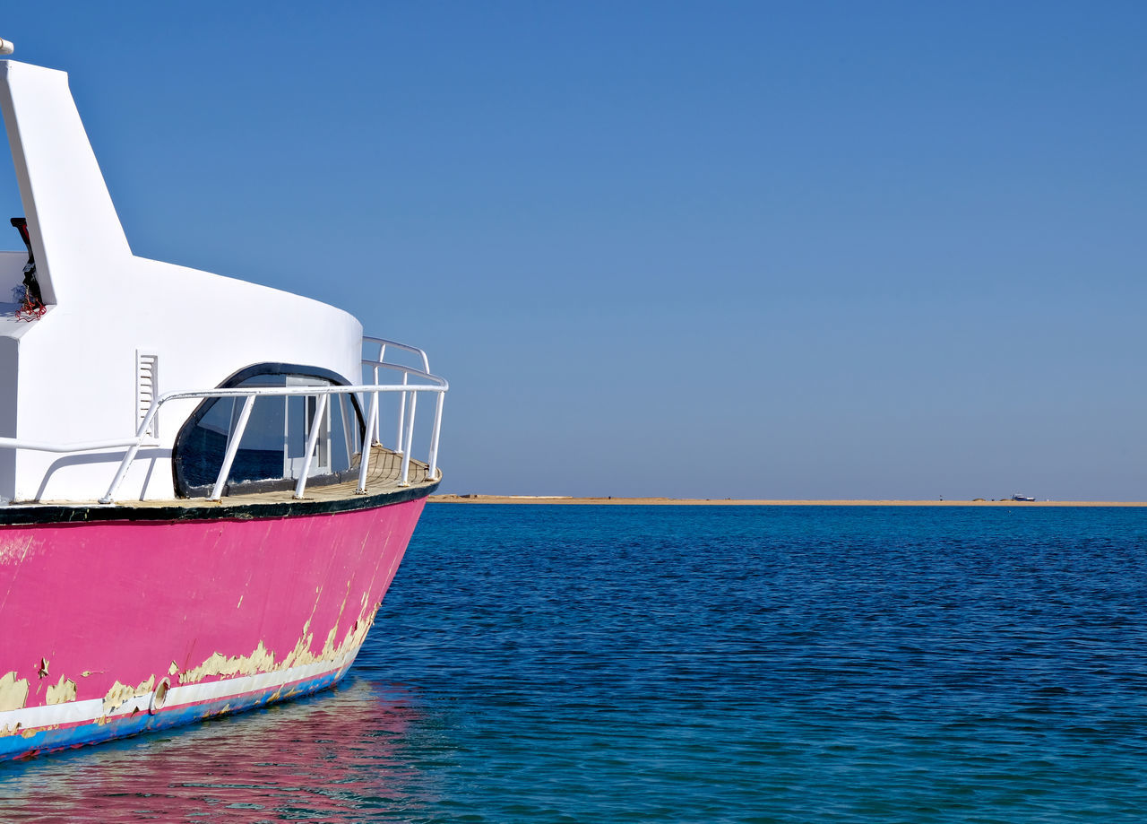 Blue Clear Sky Day Flaking Paint High Contrast Horizon Over Water Nautical Vessel No People Outdoors Pink Color Sailboat Sailing Sailing Ship Scenics Sea Sky Sunny Tranquility Transportation Travel Travel Destinations Water Yachting