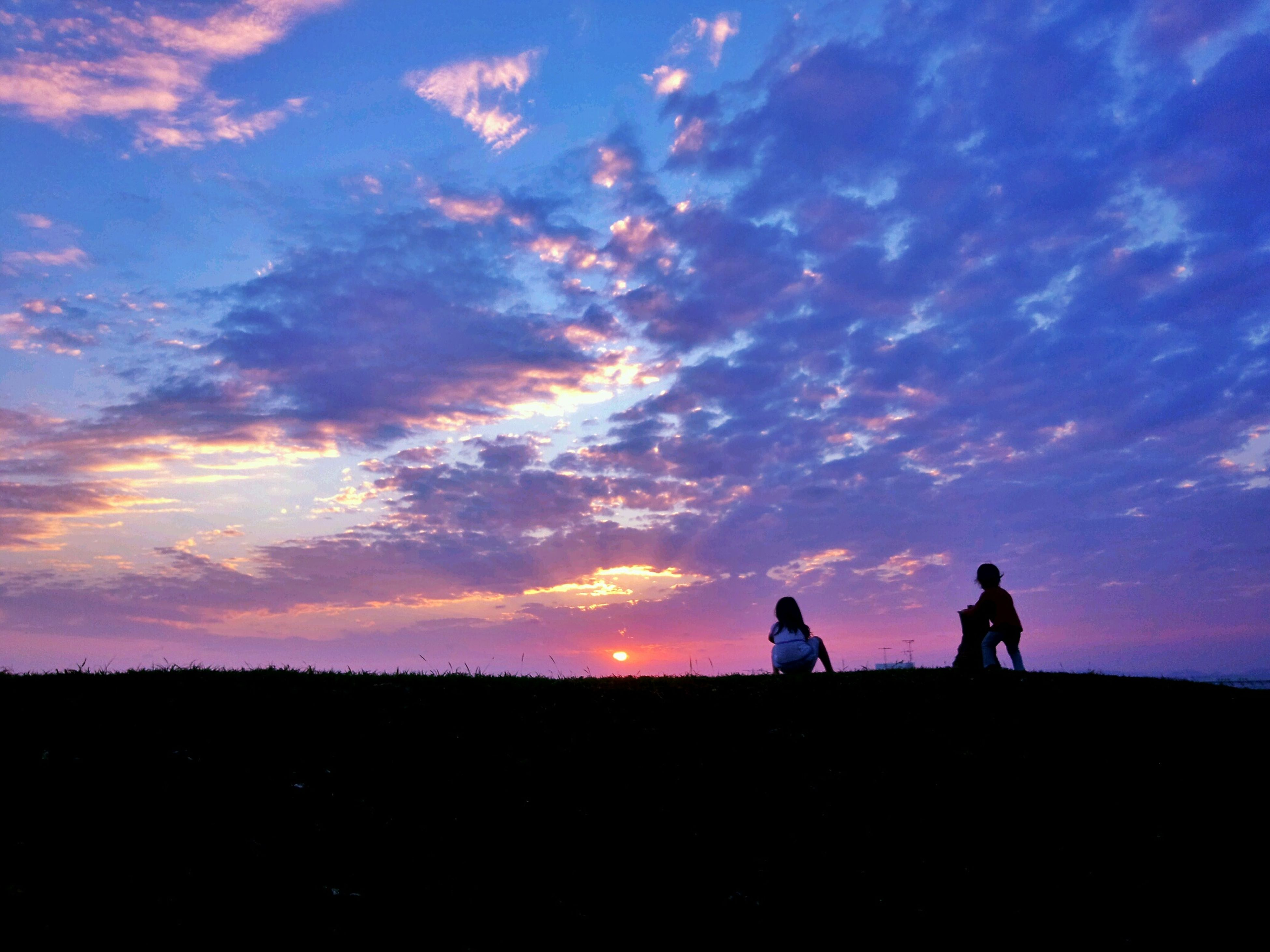 silhouette, sunset, sky, men, togetherness, lifestyles, leisure activity, beauty in nature, tranquil scene, scenics, tranquility, cloud - sky, landscape, orange color, nature, standing, bonding, person