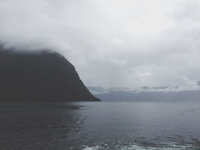 A beautiful picture of the Norwegian fjords from my boat trip from Flåm to Bergen,Norway Norwegian Fjord Fjordsofnorway Foggy Fog Mountain Mountains Foggy Weather Foggy Day Mountains And Sky Water Water Surface Boat Sea Nature Beauty In Nature Outdoors Landscape No People Miles Away Norway Norwegen Summer2016 Miles Away EyeEmNewHere