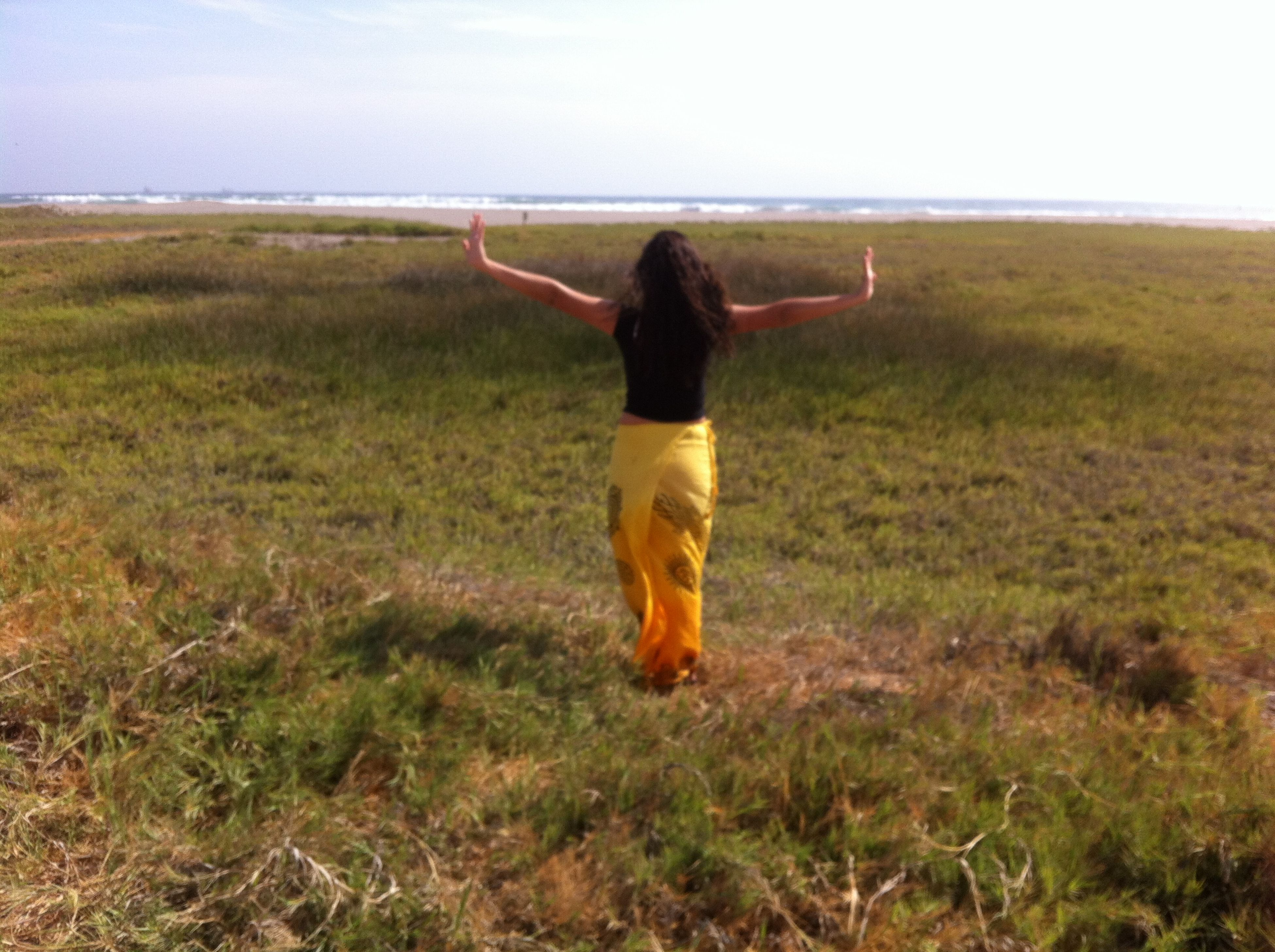grass, full length, lifestyles, field, leisure activity, standing, rear view, grassy, casual clothing, sky, landscape, tranquil scene, tranquility, nature, scenics, beauty in nature, person, getting away from it all