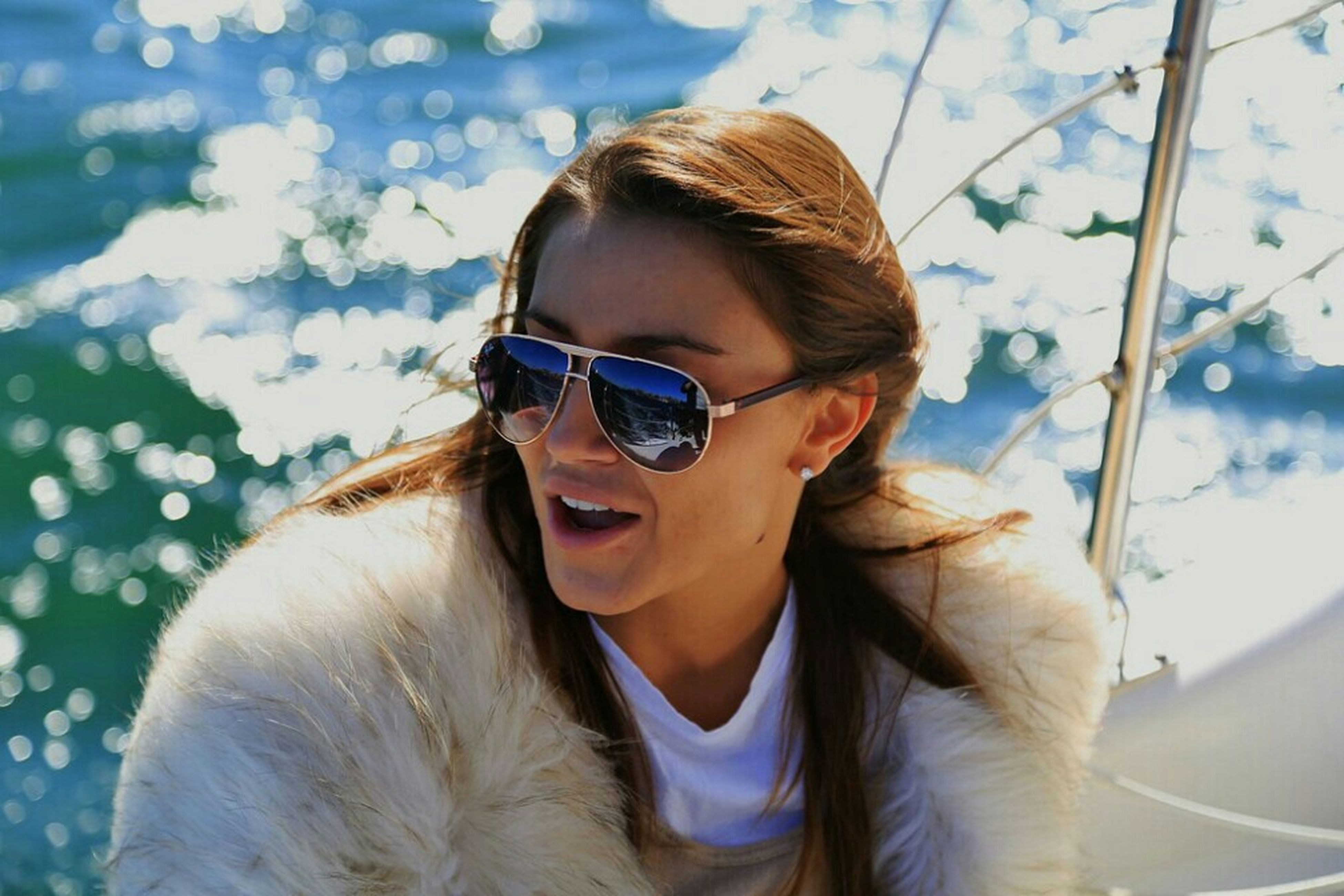 person, young adult, lifestyles, leisure activity, portrait, young women, looking at camera, headshot, sunglasses, smiling, focus on foreground, one animal, animal themes, front view, casual clothing, pets, long hair
