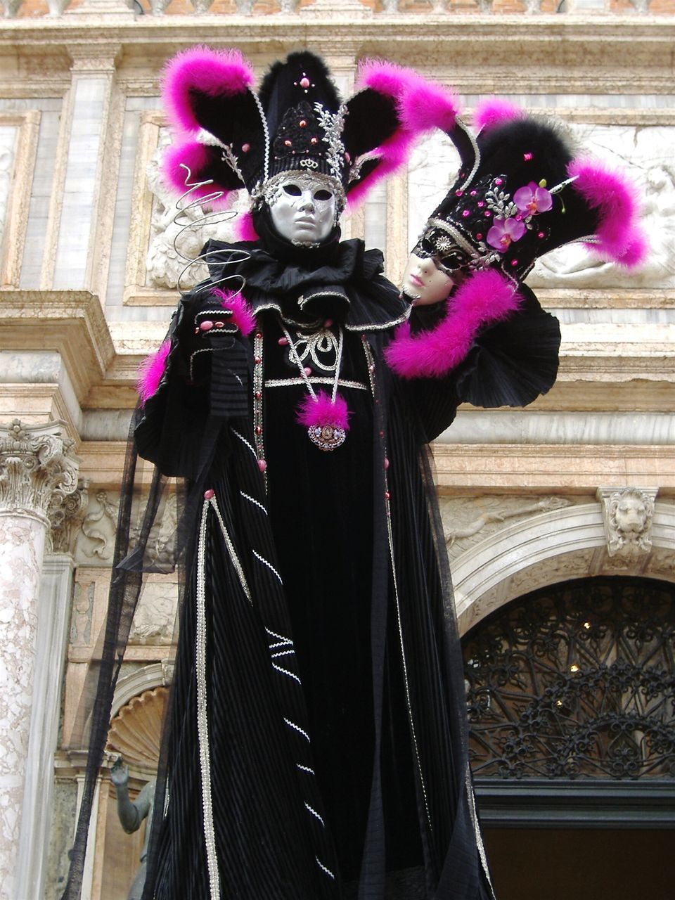 Low Angle View Of Person Wearing Venetian Mask During Carnival