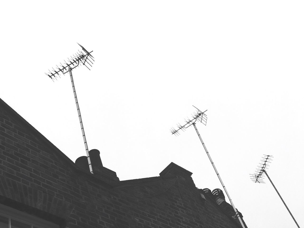 Television Aerial Antenna - Aerial Clear Sky Architecture Communication Antenna Day Outdoors Sky Rooftops Telecommunications Equipment Television Broadcast Residential  Entertainment Channels Copy Space