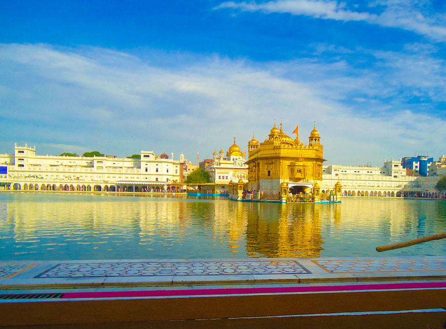 The Harmandir Sahib - known as the Golden Temple ਹਰਿਮੰਦਰ ਸਾਹਿਬ Amritsar Amritsar Punjab Amritsar, INDIA Architecture Baba Nanak Dev Building Exterior Built Structure Cloud - Sky Gold Temple Gold Temple In Indi Golden Temple Golden Temple, Amritsar GurdwaraSahib Harmandar Sahib Harmandir Sahib Made Of Gold Place Of Worship Religion Sikh Temple Sikh World View\ Sikhism Spirituality Sri Darbar Sahib Travel Destinations