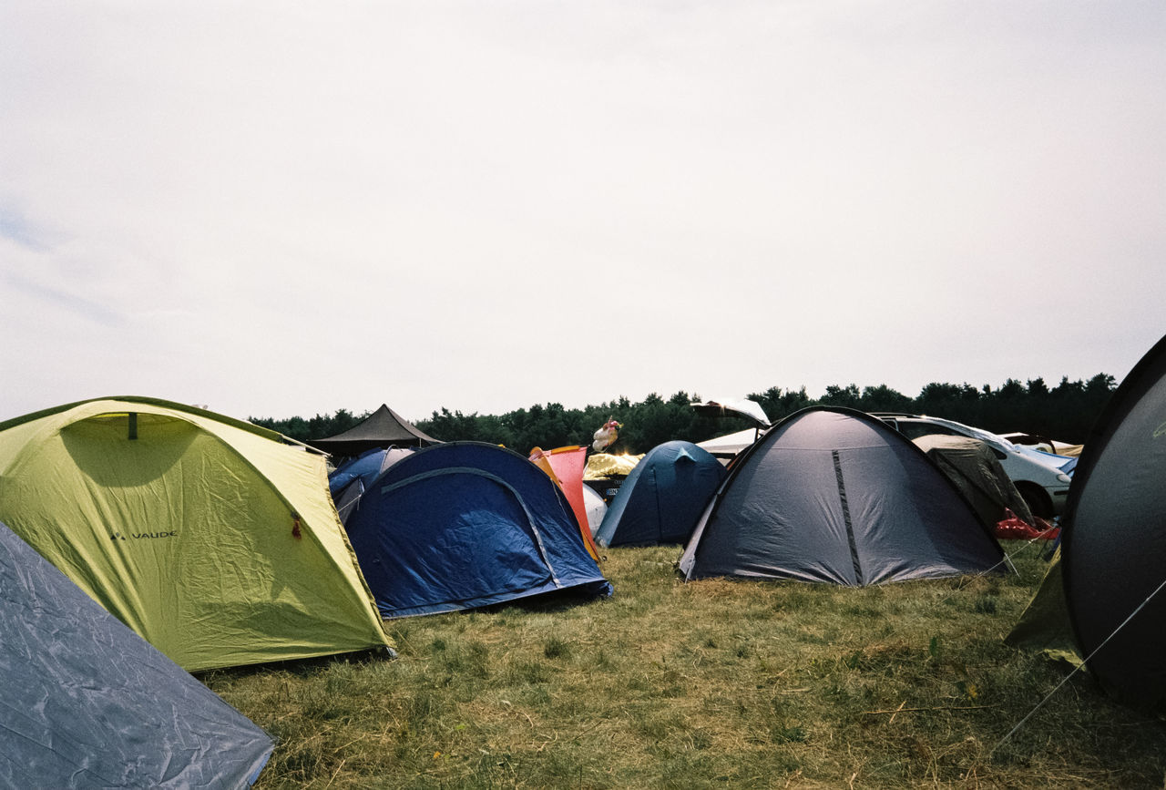 tent, camping, copy space, grass, shelter, nature, sky, day, clear sky, outdoors, adventure, beauty in nature, no people