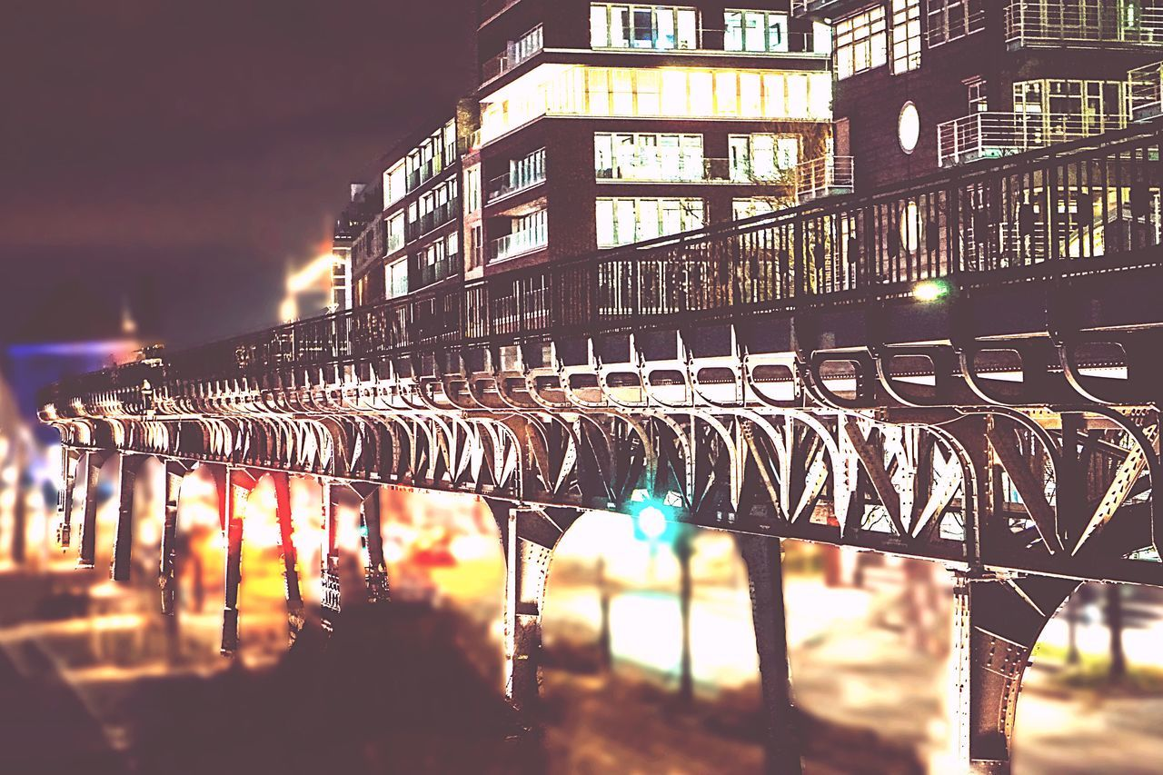 In A Row Night Illuminated Architecture City Built Structure Building Exterior Large Group Of Objects Outdoors No People Sky Close-up Bridge - Man Made Structure Subway Train Tracks Nightphotography Focus On Foreground Bokeh Photography Vintage Photo