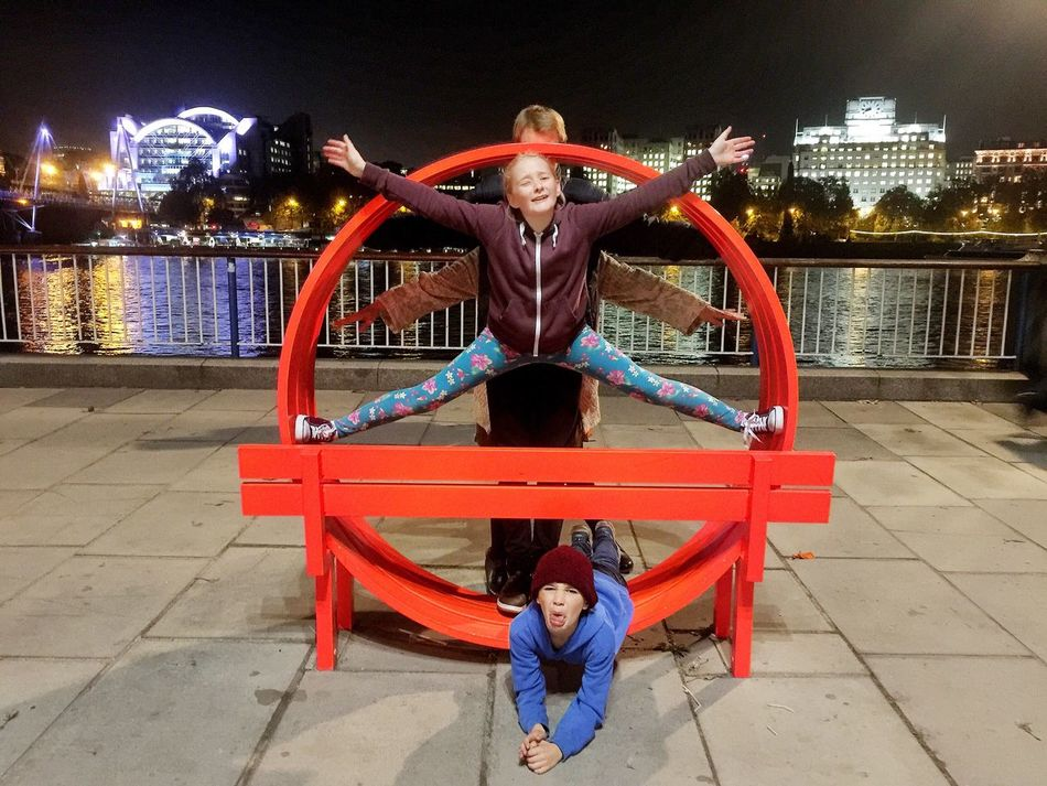 Full Length Two People Agility Balance Togetherness Flexibility Child Front View Looking At Camera Arms Raised Exercising Acrobat Arms Outstretched People Night Men Young Women Young Adult Portrait Stretching Embankment Family Family Art London Lifestyle Art Is Everywhere
