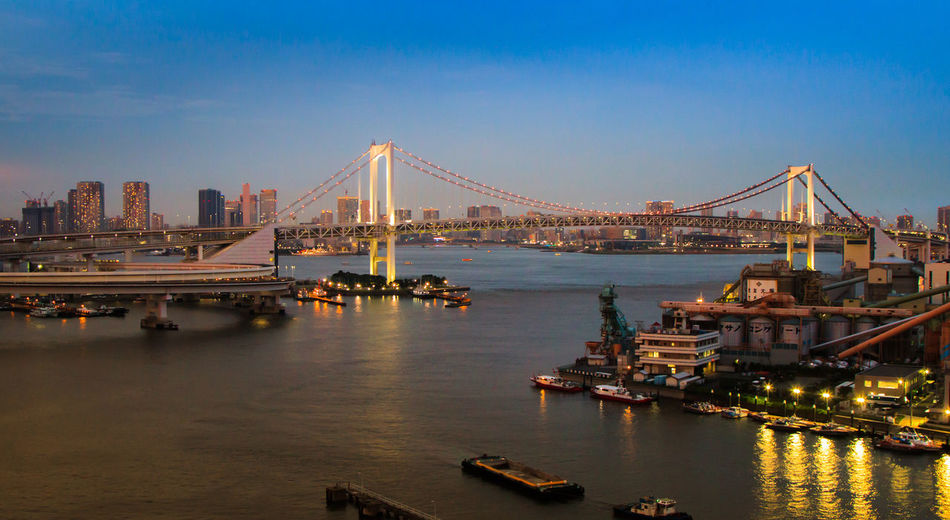 The Rainbow Bridge during Blue Hour in Tokyo Architecture Bridge - Man Made Structure Building Exterior Built Structure City Cityscape Connection Eye4photography  EyeEm Best Shots Illuminated Nature Nautical Vessel Night No People Outdoors Reflection River Sky Skyscraper Suspension Bridge Transportation Travel Travel Destinations Water Waterfront