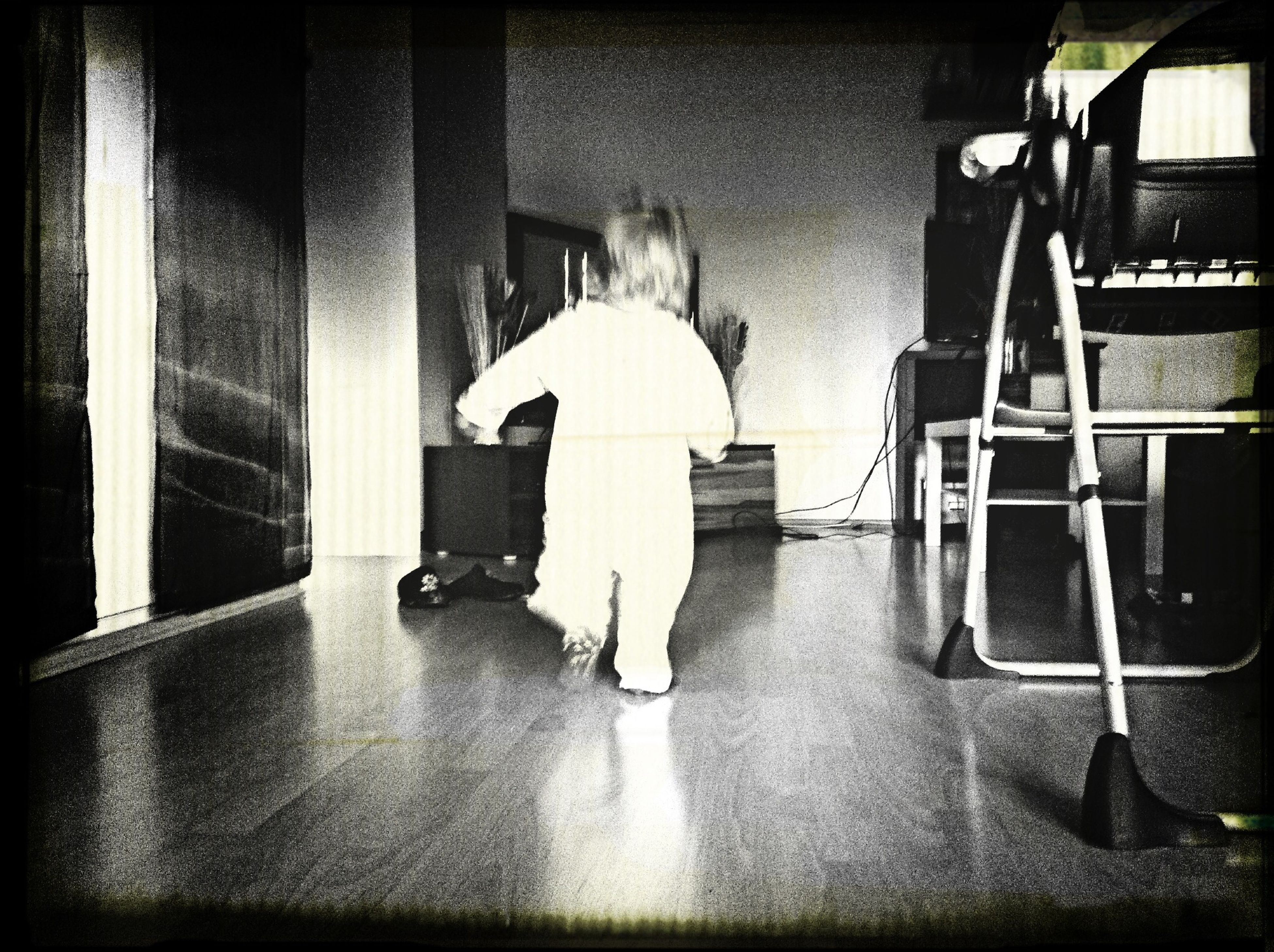 Full Length Rear View Of Baby Walking At Home
