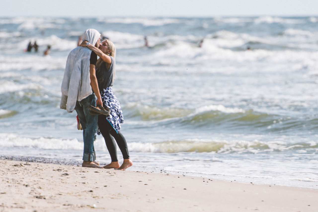 Beach Carefree Coastline Escapism Fun Getting Away From It All Kissing Love Relationship Sand Sea Seascape Vacations Water Waterfront Wave Weekend Activities Blue Wave Feel The Journey