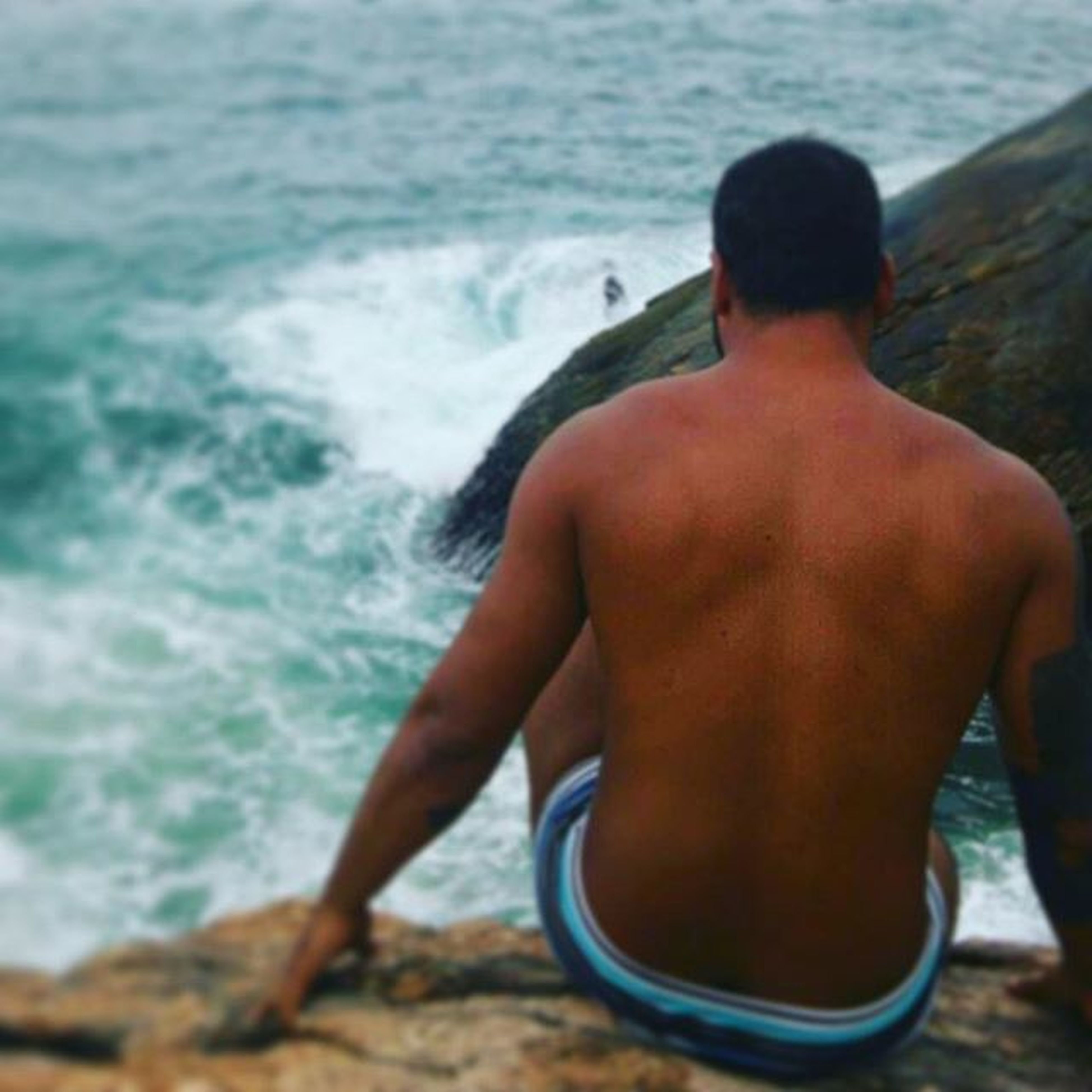 water, sea, leisure activity, lifestyles, beach, wave, vacations, rear view, men, shore, focus on foreground, nature, relaxation, surf, shirtless, day, person, outdoors