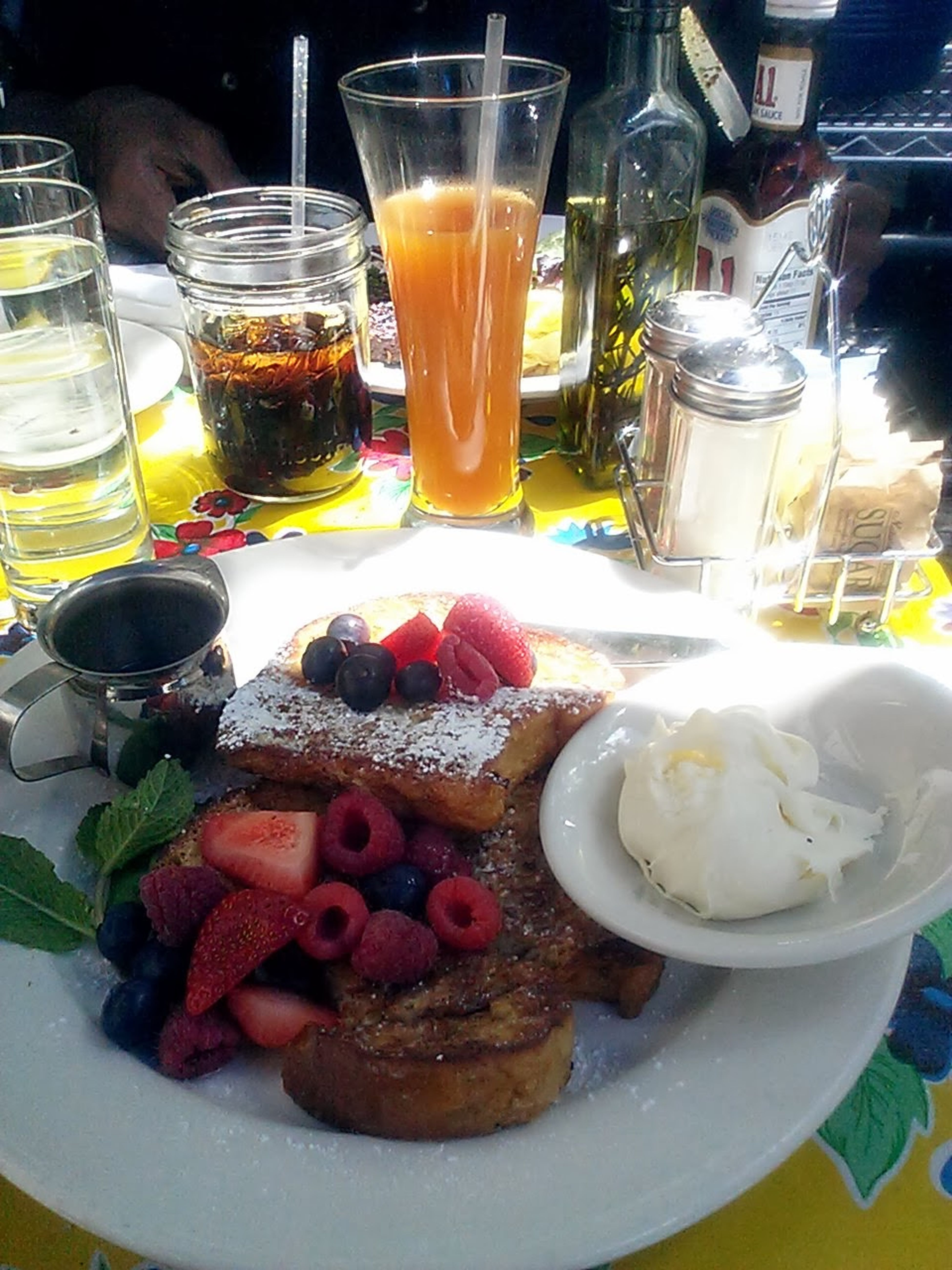 The EyeEm Breakfast Club Italian Frenchtoast Brunch topped w/ raspberries, blueberries, syrup... mascaprone on the side & a tall glass of fresh apricot juice. yum!