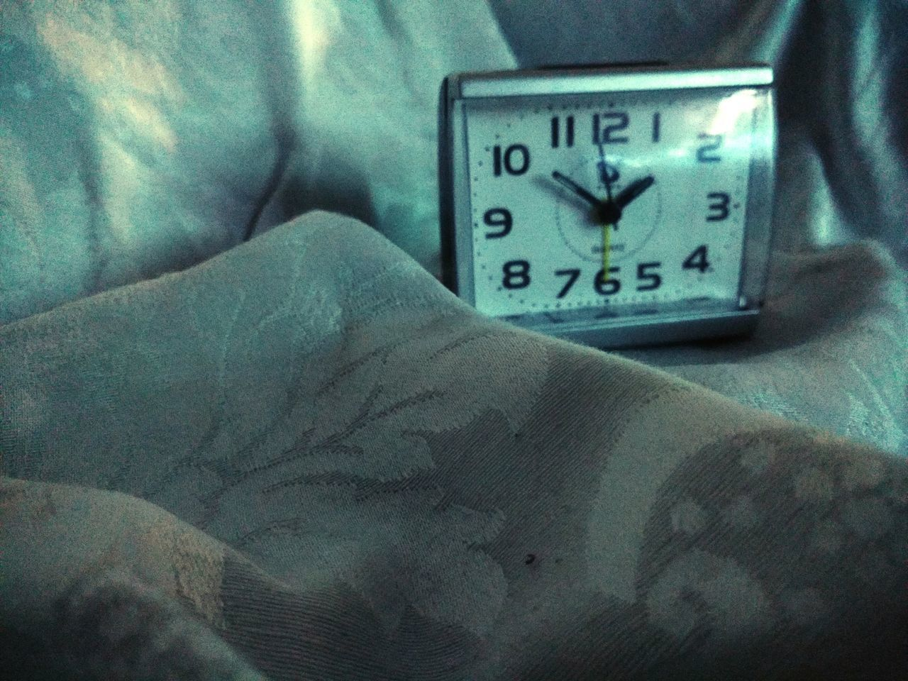 number, time, indoors, bed, clock, alarm clock, text, communication, bedroom, no people, minute hand, close-up, pillow, day, hour hand, clock face