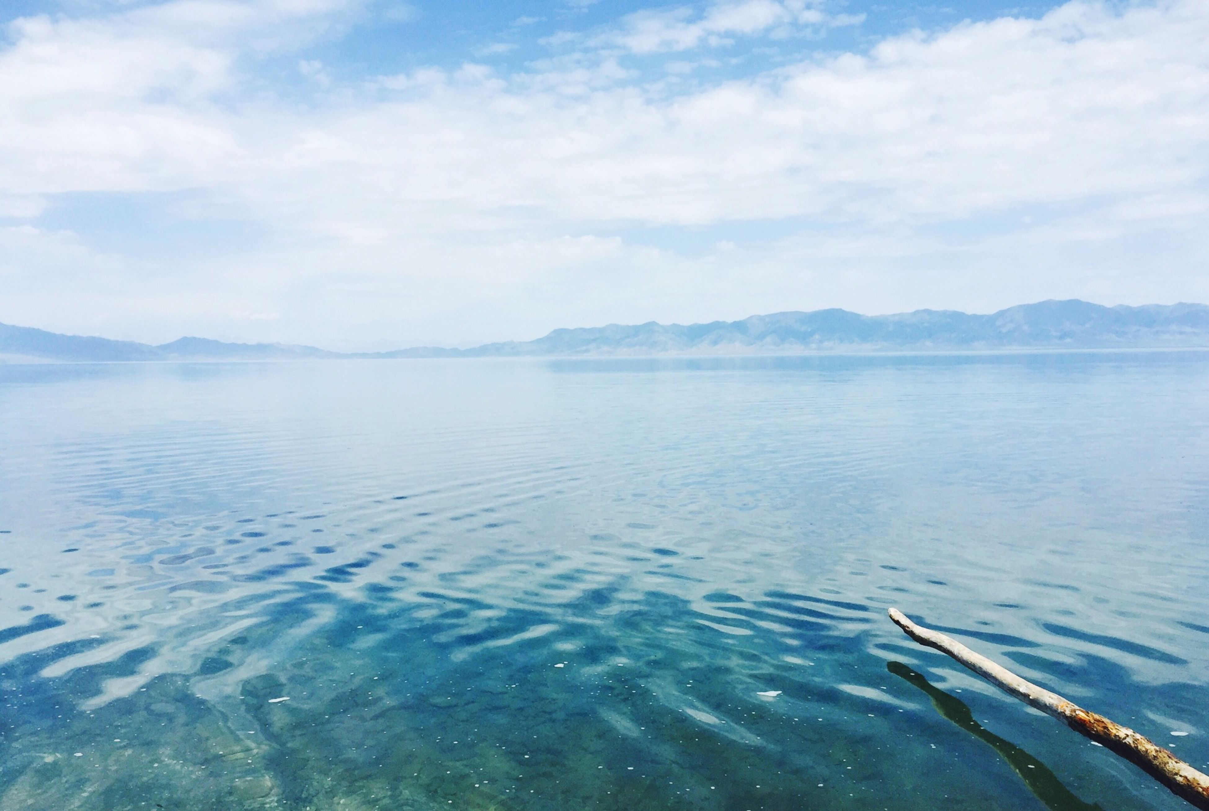 water, tranquil scene, mountain, sky, scenics, tranquility, beauty in nature, waterfront, sea, nature, lake, cloud - sky, rippled, mountain range, idyllic, cloud, day, cloudy, outdoors, non-urban scene