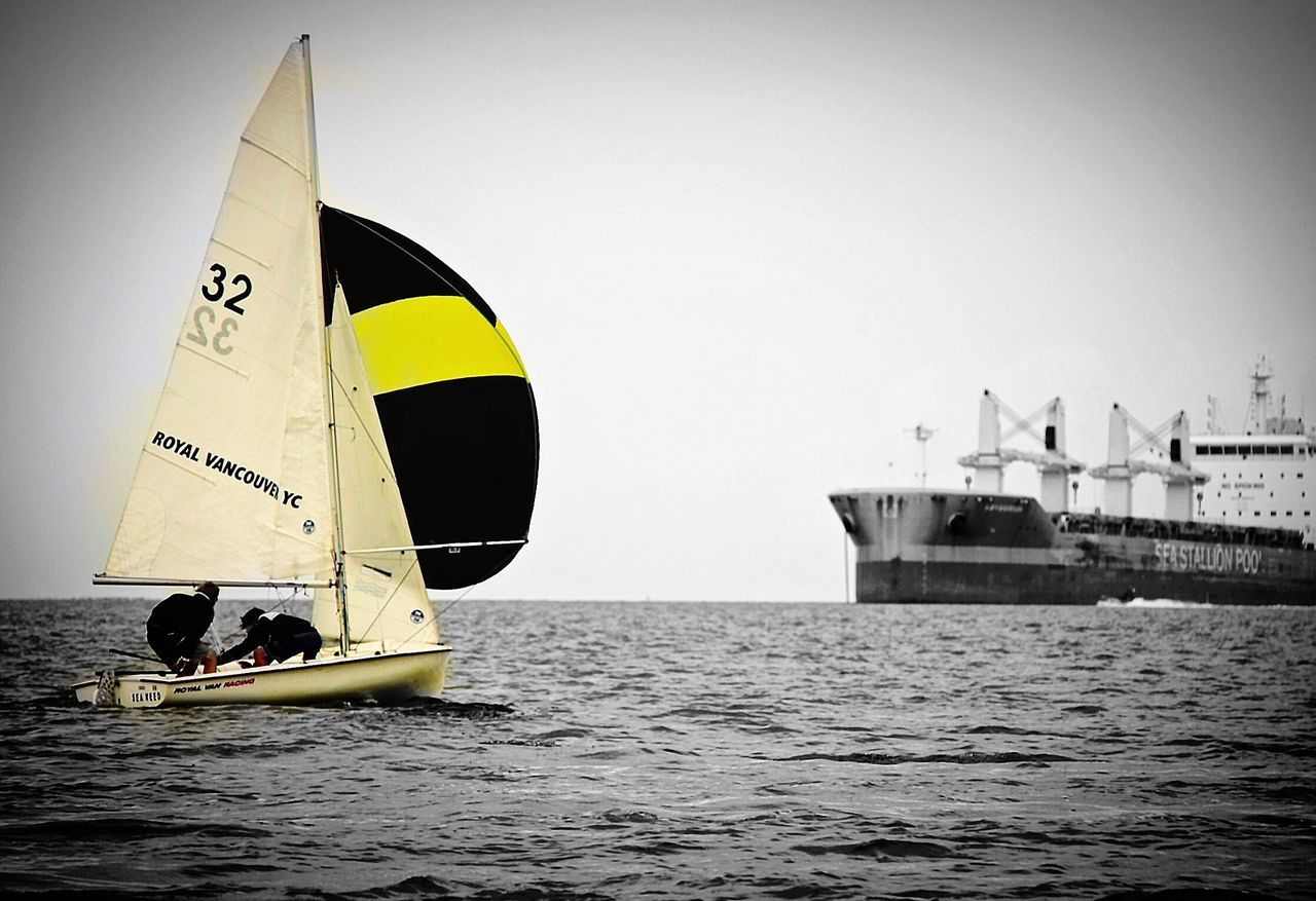 Sailing away. Adventure Sea Transportation Leisure Activity Water Extreme Sports Real People One Person Men Nautical Vessel Outdoors Sport Day Sky Lifestyles Nature Sailing Downwind Spinnaker Downind Clear Sky Sun One Man Only People