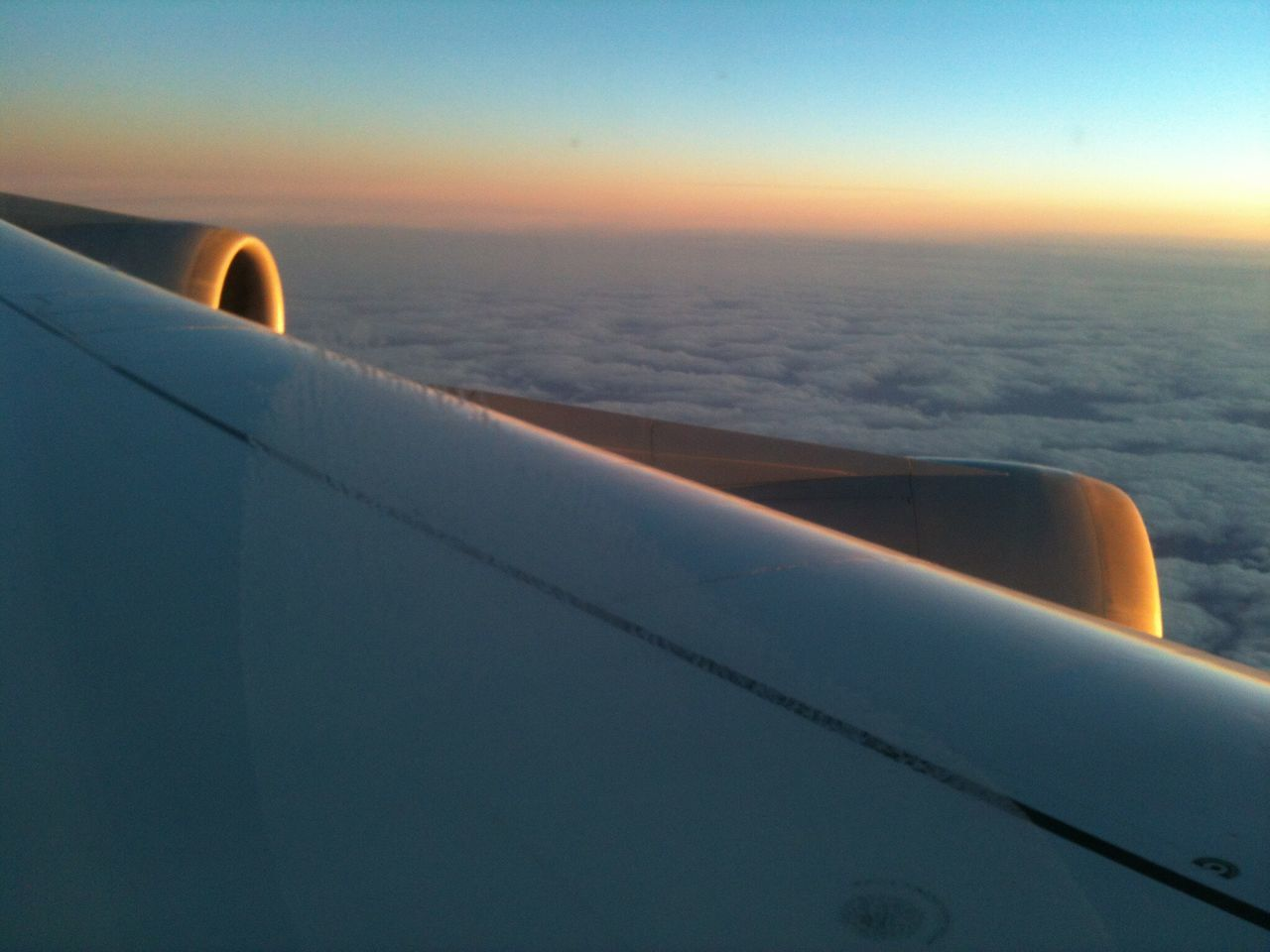 airplane, transportation, mode of transport, air vehicle, journey, travel, sea, no people, aircraft wing, jet engine, airplane wing, aerial view, flying, sunset, vehicle part, day, outdoors, close-up, sky, water, beauty in nature, nature, commercial airplane