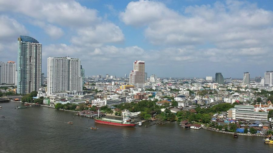Chao Phaya River City Skyline Bangkok Thailand. View from balcony Clouds And Sky Sky Scrapers Balcony View Bangkok Skyline Bangkok Thailand White Album The Purist (no Edit, No Filter) The White Album The White Collection Studies Of Whiteness White Study Of Whiteness White & Whiteness Whiteness White Collection White Clouds