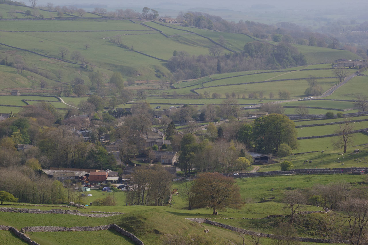 A view of the village of Malham from the top of Malham Cove Agriculture Field Landscape Rural Scene Farm Beauty In Nature Nature Outdoors Tranquility Tranquil Scene Yorkshire Dales Yorkshire Dales Uk United Kingdom English Countryside Malham Cove Malham Sky Day Tree No People Village