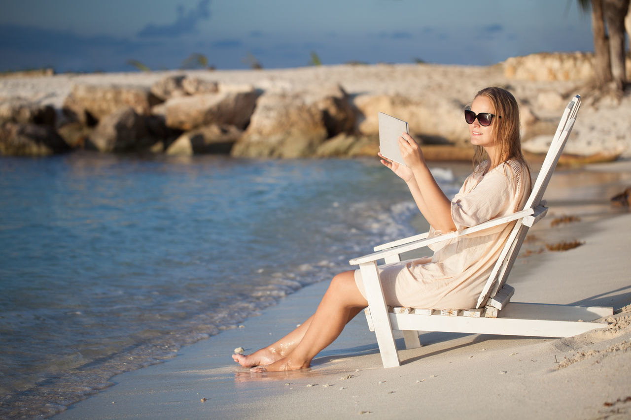 Beach Caucasian Chaise-longue Deck Chair Deck-chair Horizontal Ocean Pad Portable Relaxation Sea Seascape Seaside Shore Shot Tablet Take Picture Vacations Water Women