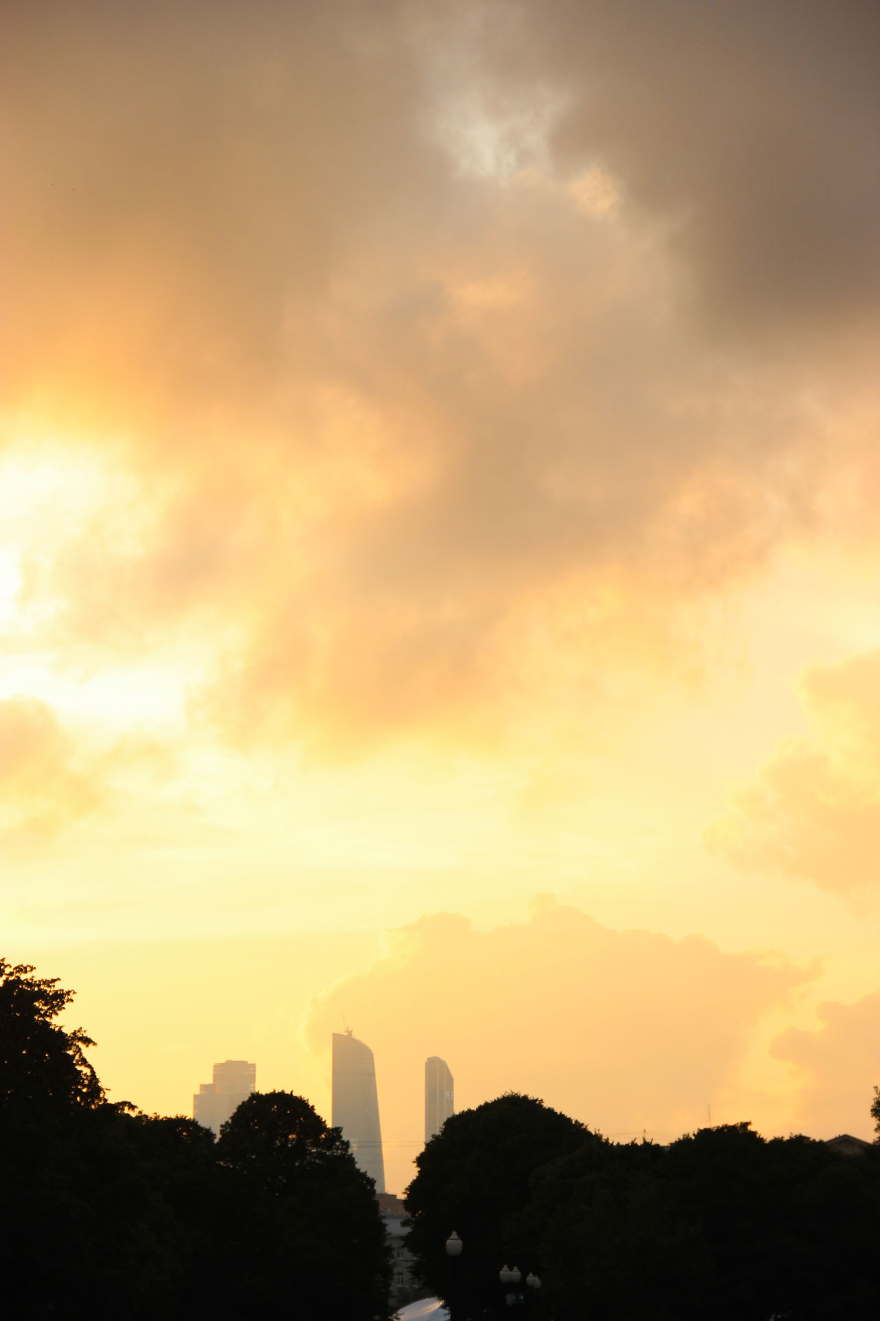 """""""evening sky on fire"""" Architecture Astronomy Beauty In Nature City Life Cityscape Cloud - Sky Clouds Clouds And Sky Cloudscape Cloudsporn Fire First Eyeem Photo Nature No People Outdoors Park Silhouette Silhouette Sky Skyline Space Sunset Tower Traveling Yellow"""