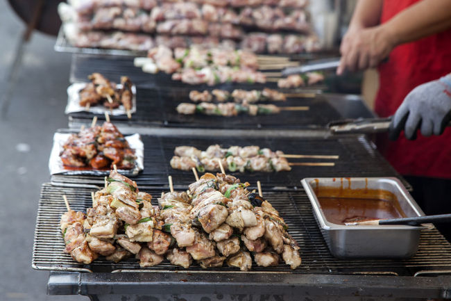 Market of Korea street food Adult Barbecue Barbecue Grill Chicken Skewers Day Focus On Foreground Food Food And Drink Freshness Grilled Grilling Holiday Horizontal Human Body Part Leisure Activity Market Stall Men One Person Outdoors People Person Ready-to-eat Skewer Spicy Street Food