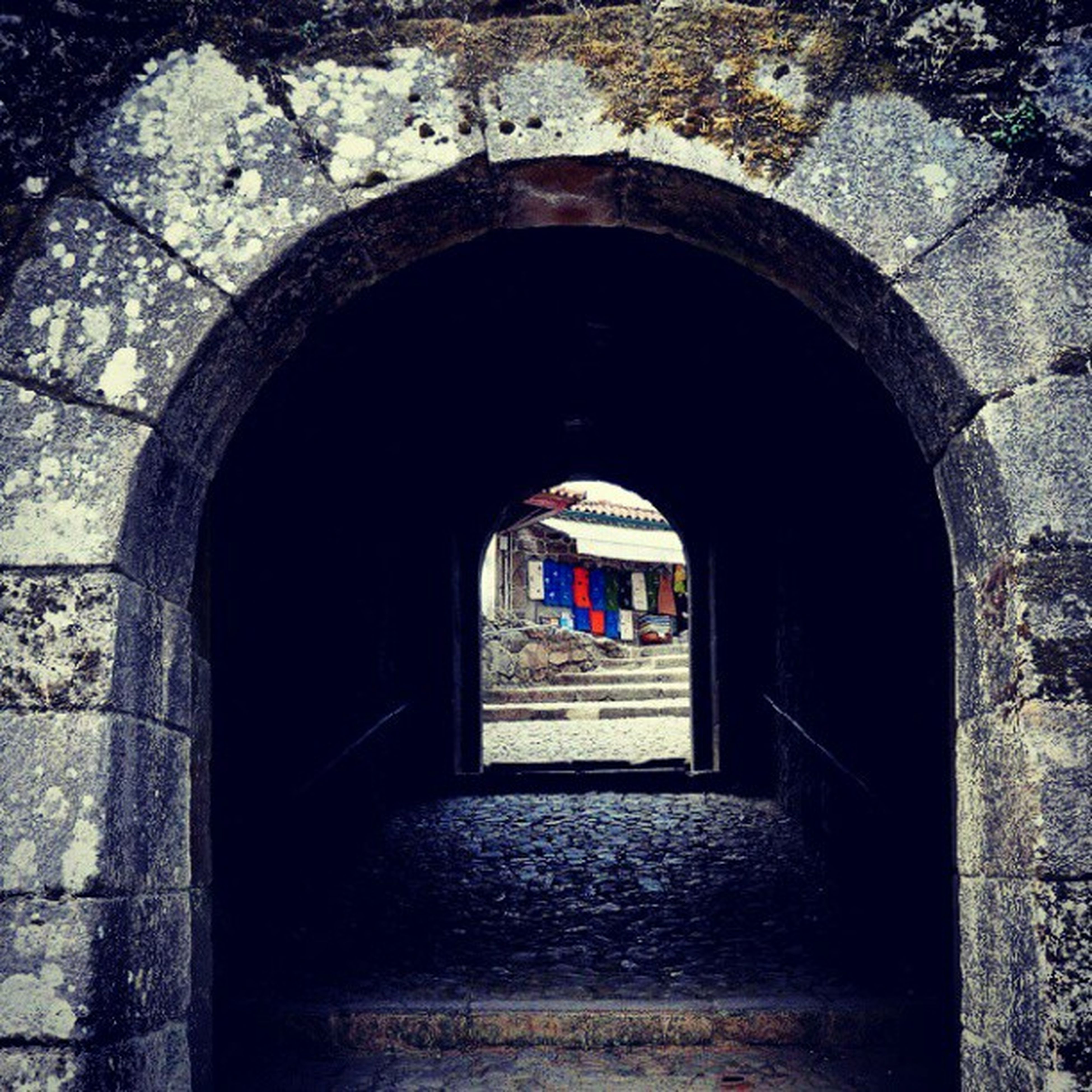 arch, architecture, built structure, the way forward, archway, tunnel, stone wall, building exterior, indoors, history, old, steps, diminishing perspective, arched, entrance, wall - building feature, walkway, day, cobblestone, narrow