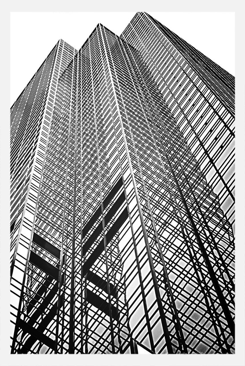 architecture, low angle view, built structure, building exterior, modern, skyscraper, sky, day, no people, outdoors, fire escape, city