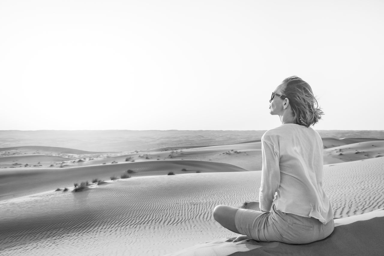 Blackandwhite Calm Desert Landscape Leisure Activity Meditate, Contemplate, Think, Consider, Ponder, Muse, Reflect, Deliberate Meditation Nature Oman One Person Peace Real People Relax Sand Sitting Sunset Tranquil Scene Wahiba Sands Women
