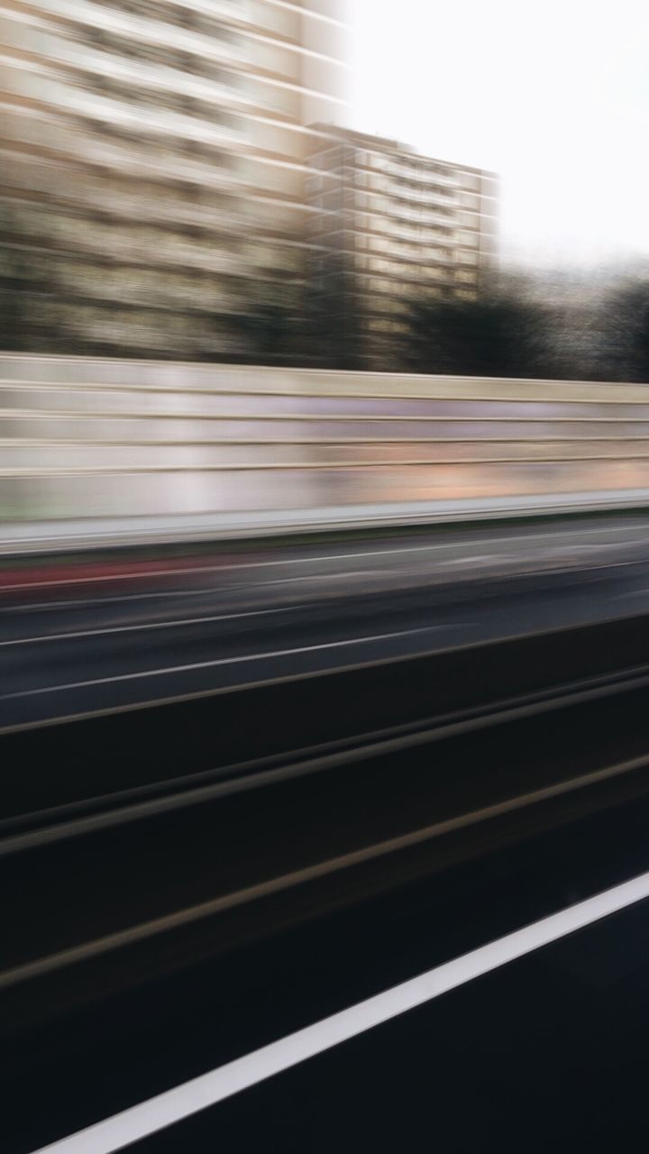 blurred motion, speed, motion, transportation, no people, outdoors, day, city, close-up, sky
