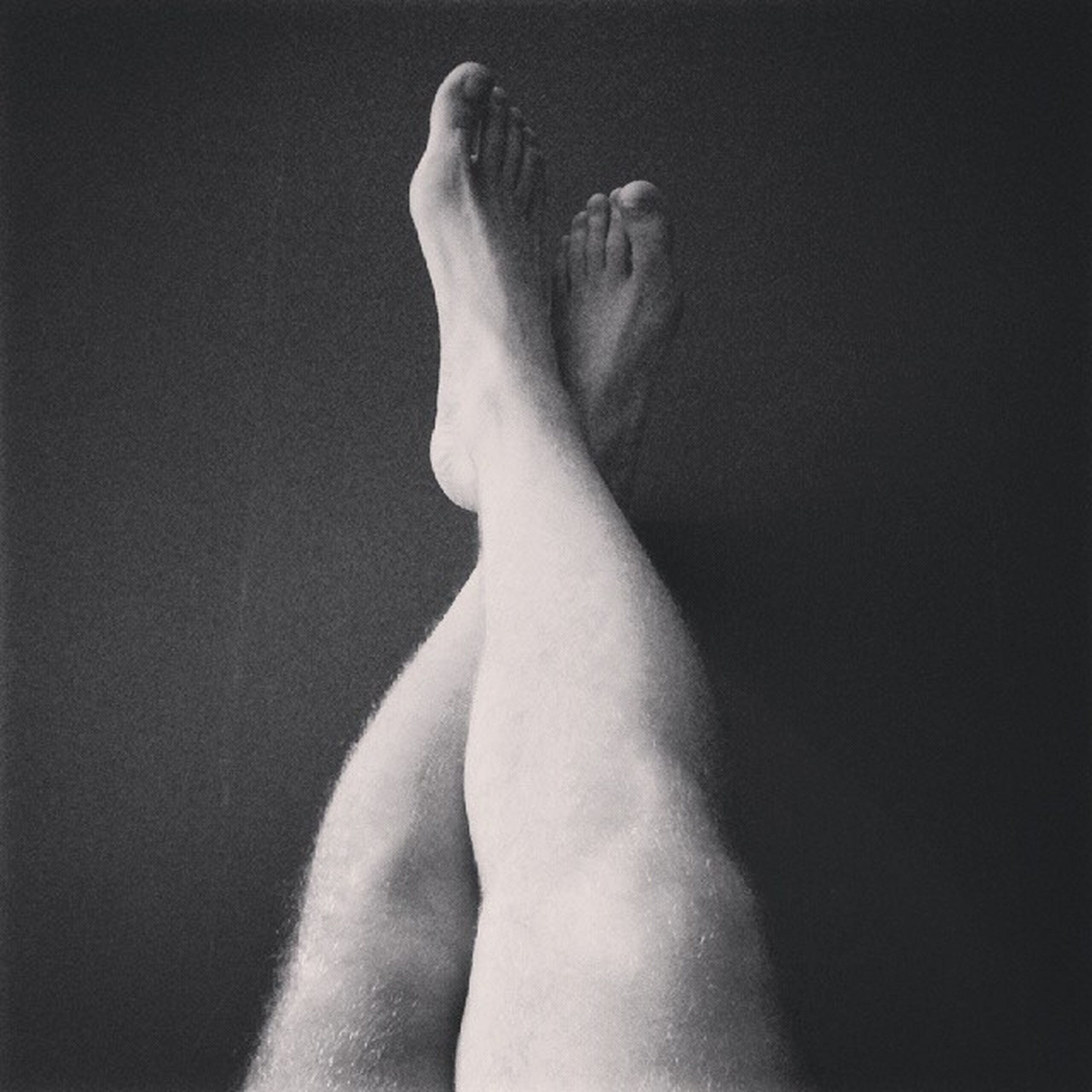 person, indoors, personal perspective, low section, relaxation, white color, lifestyles, barefoot, part of, copy space, sensuality, leisure activity, human foot, studio shot, resting