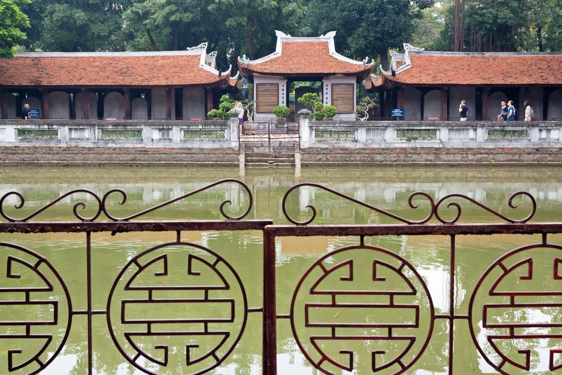 At the Temple of Literature Van Mieu, 2016. Ancient Architecture ASIA Building Exterior Culture Day Fence Hanoi Historic History Horizontal Literature Reflections In The Water Sightseeing Sightseeing Spot Temple Temple Of Literature Tourism Touristic Travel Travel Destinations Trees Vietnam Văn Miếu Water