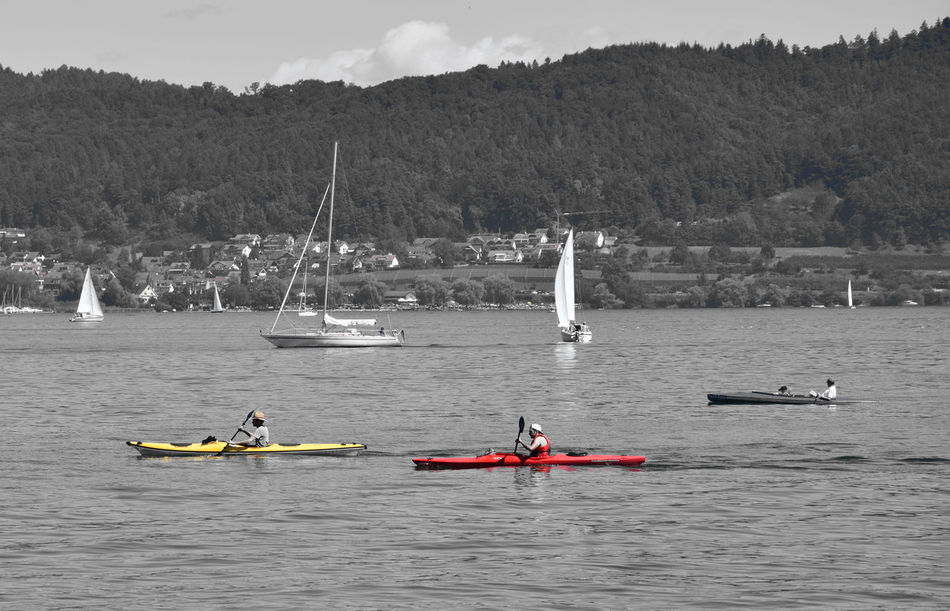 Yellow and red Activity Black And White With A Splash Of Colour Boat Boats Boats⛵️ Journey Mode Of Transport Nature Nautical Vessel Non-urban Scene Red Sailing Sea Tourism Tranquil Scene Transportation Water Water Sports Waterfront Yellow