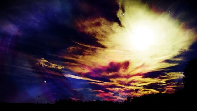A shot of the sky from an afternoon drive with a lot of layering and tweaks. Silhouette Sky Beauty In Nature Cloud - Sky Multi Colored Cloud Dramatic Sky Atmospheric Mood Cloudscape Non-urban Scene Layers And Textures Layers And Colors Layered Landscape