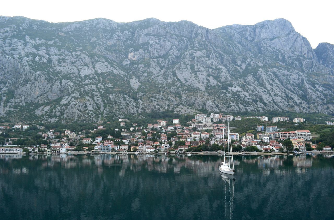 Reflecting dawn Kotor Cattaro Montenegro Reflection Water Boat Town Mountain Sea Nature Outdoors Landscape Beauty In Nature Scenics No People Dawn