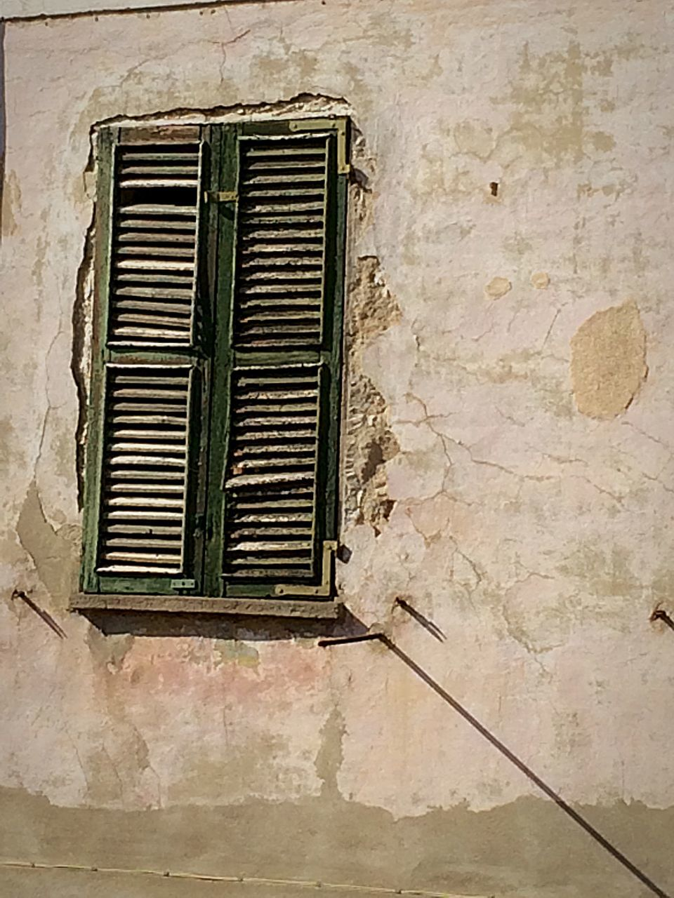 window, wall - building feature, architecture, built structure, air duct, building exterior, weathered, no people, day, metal grate, outdoors, close-up