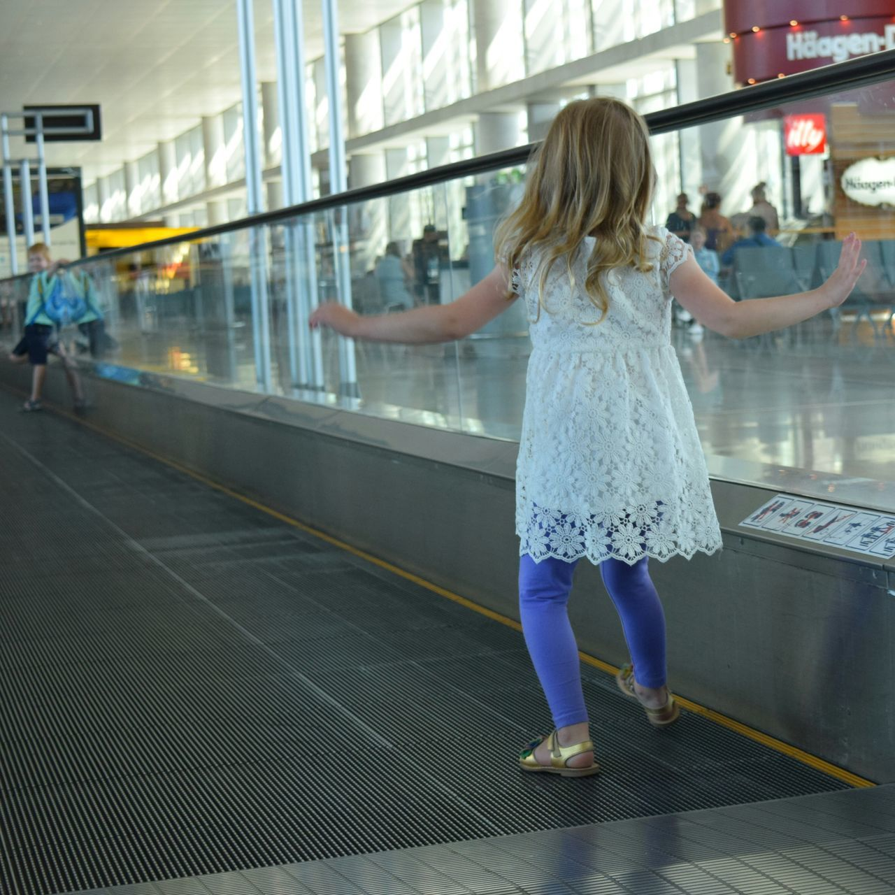 Airport Sliding Scale Boy And Girl Playing Barcelona On The Way