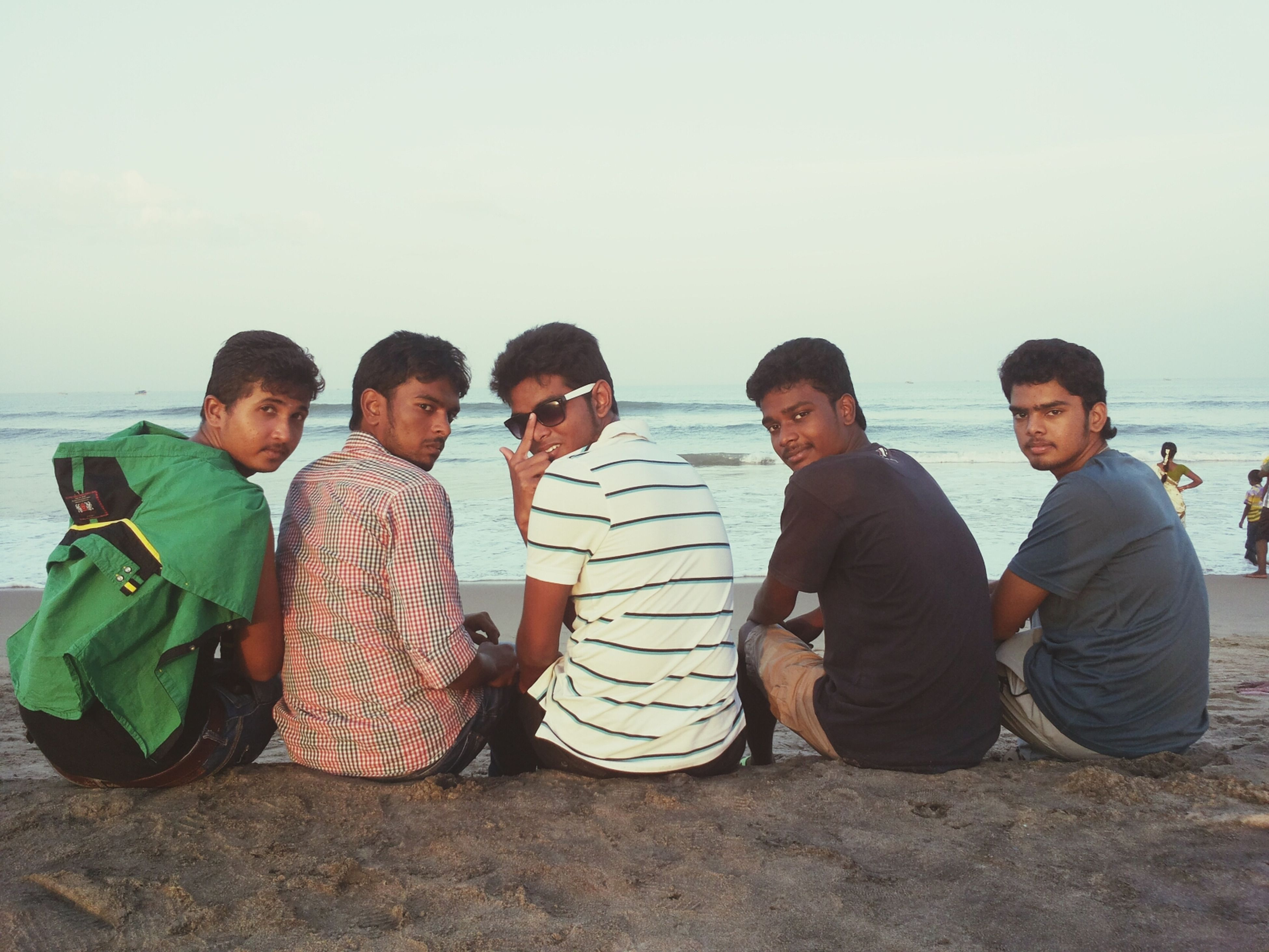 togetherness, bonding, lifestyles, leisure activity, love, casual clothing, friendship, family, sea, boys, young men, beach, person, sitting, childhood, vacations, sibling, water