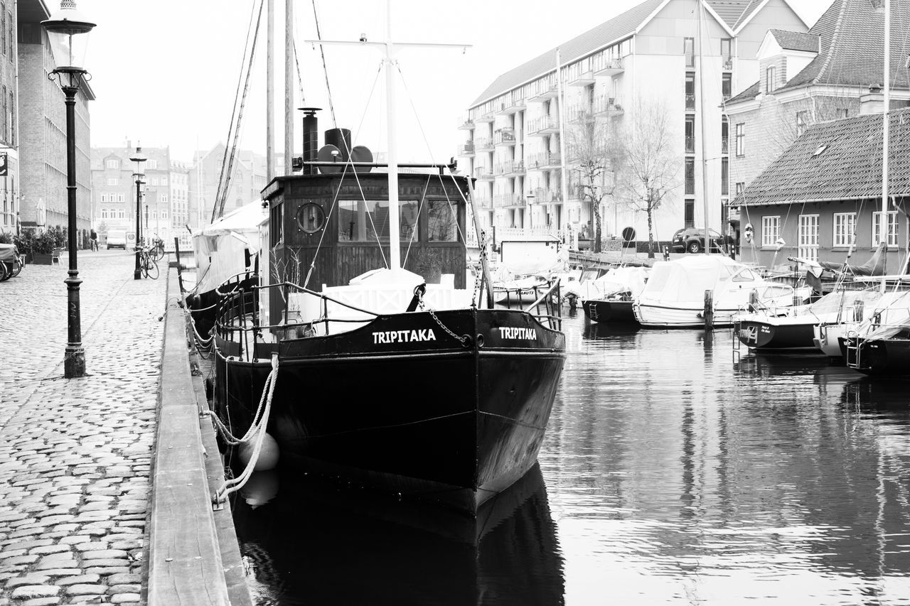 Architecture B&w Black And White Boat Building Exterior Built Structure Canals Canals And Waterways City Copenhagen, Denmark Day Men Misty Day Misty Morning Mode Of Transport Moored Nautical Vessel Outdoors People Reflection Ship Sky Transportation Water Waterfront
