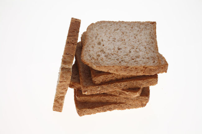 slices of Wholemeal toast bread on white Bread Brown Close-up Cut Out Food Food And Drink Freshness Indulgence No People Overhead View Ready-to-eat Slices Still Life Studio Shot Temptation Toastbread Toast🍞 White Background Wholemeal Wholemeal Bread