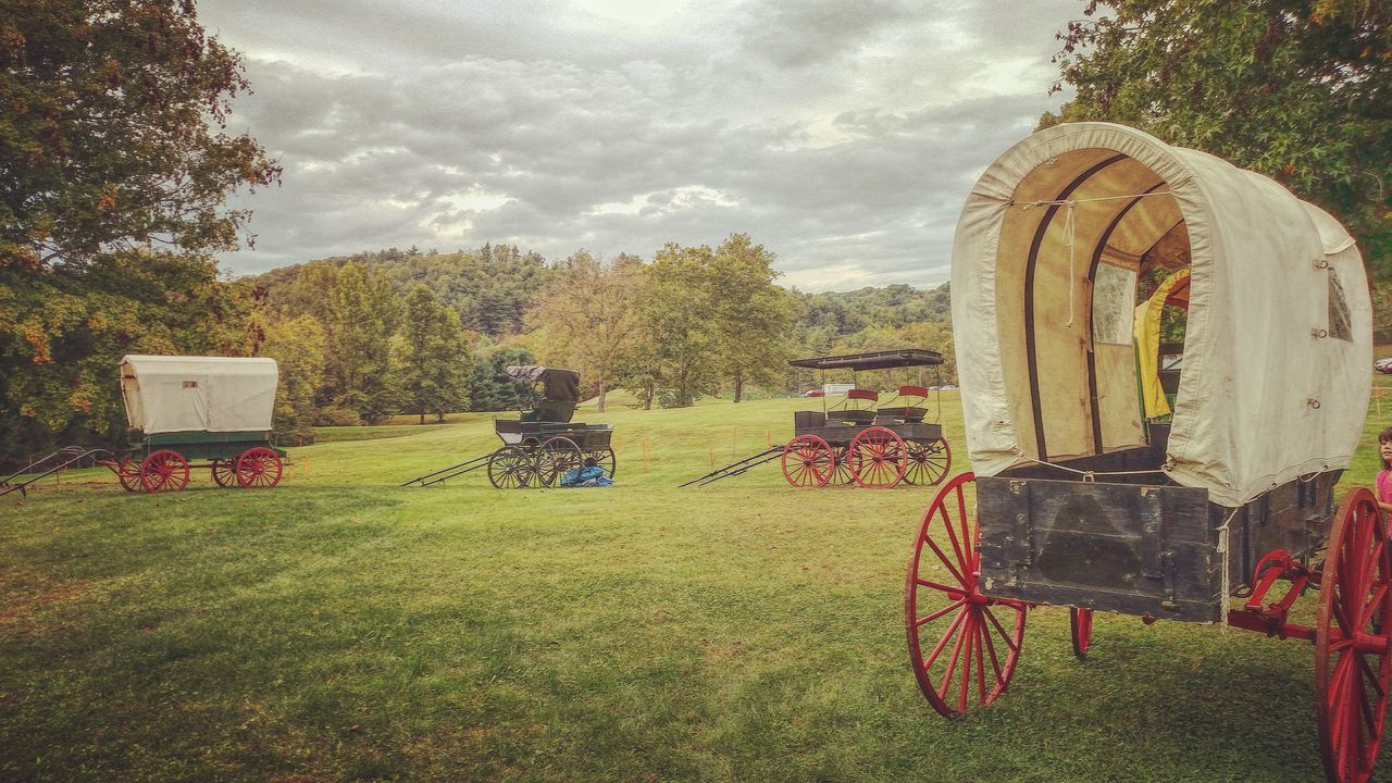 Happy trails. Grass Tree Cloud Park - Man Made Space Sky Day Solitude No People Tranquil Scene Outdoors Lawn Memories Tranquility Wagon  Wagonwheel Covered Wagons