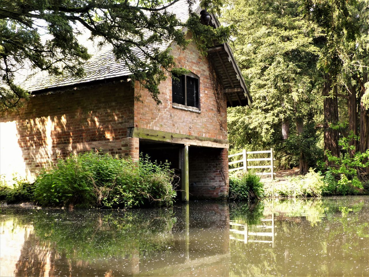 architecture, tree, reflection, building exterior, built structure, outdoors, water, no people, house, plant, day, nature, watermill, grass, sky