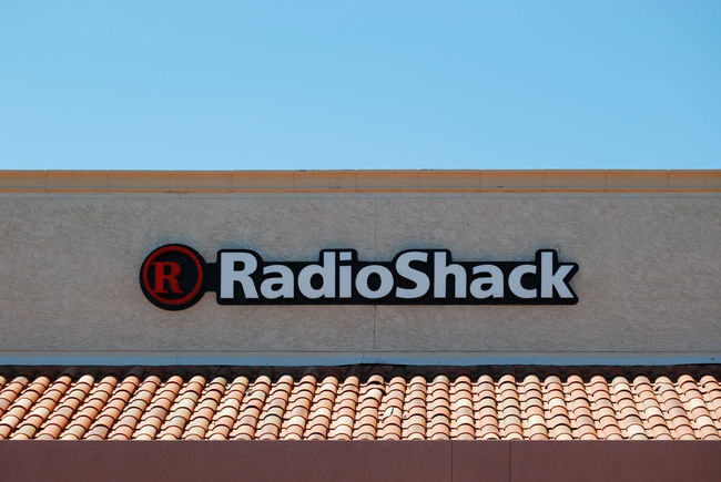 Radio shack is an American retail consumer electronics store founded in 1921, formerly Tandy Corporation. It's headquarted in Fort Worth, Texas. August 6, 2014 Architecture Blue Building Building Exterior Built Structure Close-up Consumer Electronics Day Editorial Photography Facade Building High Section Information Information Sign Logo Low Angle View No People Outdoors Radio Shack Roof Sky Storefront Text